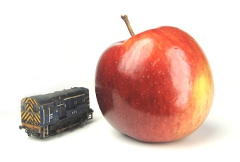 A picture of a weathered Class 08, next to a tasty apple.