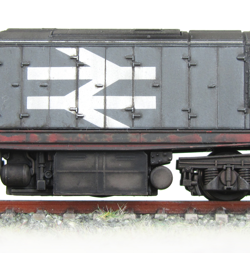 58029 showing the dappled fading effect on the panels and paint peeling on the underframe.