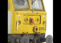A picture of 47200 showing a full respray into Cotswold Rail livery. Base model has been converted to a cutaway buffer beam example with etched kick plates and modified battery box. Other details include: detailed buffer beam at one end, moulded nose handrails replaced with wire, renumbered, etched nameplates, moulded roof grills replaced with etched fan and grill, pipe added to nose, body lowered, finer ariels, snowploughs and nose catch added