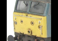 A picture of 47816 showing a full respray into FGW in it's final days and one end converted to a flush front. Base model has been converted to a cutaway buffer beam example with etched kick plates and modified battery box. Other details include: detailed buffer beam at one end and semi detailed at coupling end, driver fitted, moulded nose handrails replaced with wire, renumbered, moulded roof grills replaced with etched fan and grill, body lowered, finer ariels, and nose catch added