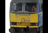 A picture of 60078 Faded Mainline livery, detailed buffer beam at one end, body lowered, EWS sticker added along with yellow snowploughs, driver and paint flaking on window surrounds.