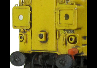 A picture of 37038 with full respray into DRS livery with boiler ports plated over. Other details include bogie modification to reduce gap between body and bogies, moulded roof grill replaced with 3D etched fan and grill, finer aerial, speedo cable added, etched air horn covers and different headcode surrounds, driver, renumbered, detailed buffer beam at one end with semi detailed at coupling end.