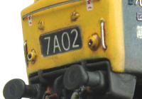 A picture of D7096 with detailed buffer beam, renumbered with metal numbers, etched work plates and change of headcode,