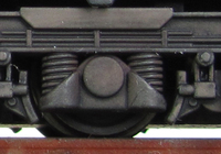 A picture of Close up of class 58 bogies. Note the silver of the metal breaking through on the foot steps.