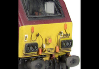 A picture of 67004 with detailed buffer beam at one end and semi detailed at coupler end, moulded jumper cables replaced with wire versions, renumbered, etched nameplates and driver fitted.