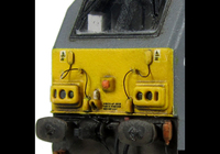 A picture of 67014 with detailed buffer beam at one end and semi detailed at coupler end, moulded jumper cables replaced with wire versions, renumbered, etched nameplates and driver fitted.