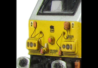 A picture of 67029 with detailed buffer beam at one end and semi detailed at coupler end, moulded jumper cables replaced with wire versions, etched nameplates and driver fitted.